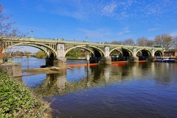 Richmond Lock and Footbridge is a lock, rising and falling low-tide barrage integrating controlled sluices and pair of pedestrian bridges on the River Thames in south west London, England.