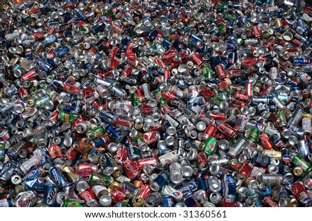 RICHMOND, VA - CIRCA 2009: Aluminum cans lie in a heap at an undisclosed recycling facility circa 2009 in Richmond. The cans will be compressed and baled. - stock photo