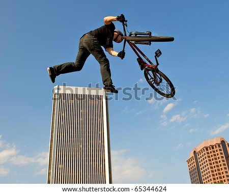 RICHMOND, VA - MAY 14: Clint McMahon performs freestyle bike tricks during the Dominion Riverrock event on May 14, 2010 in Richmond, VA.