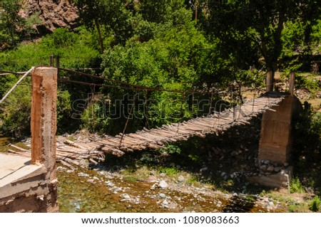 Rickety wooden bridge over the River Ourika high up in the Atlas Mountains, Morocco