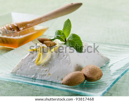 ricotta pudding with almond, honey and mint leaf