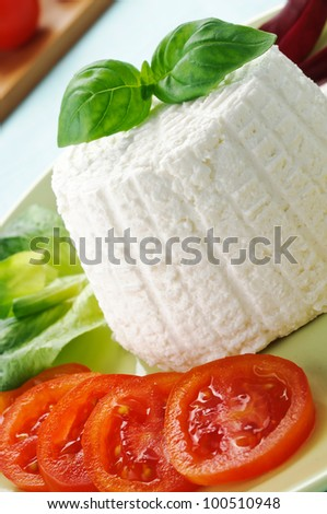 Ricotta with basil and tomato, closeup
