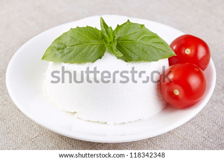 Ricotta with cherry tomatoes and a basil