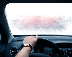 Ride on a snowy winter day with a frozen car window