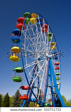 Ride on Ferris wheel in Amusement Park