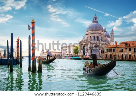 Ride on gondolas along the Gand Canal in Venice, Italy #1129446635