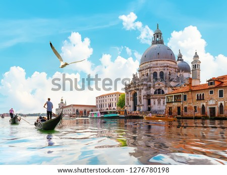Ride on gondolas along the Gand Canal in Venice, Italy #1276780198