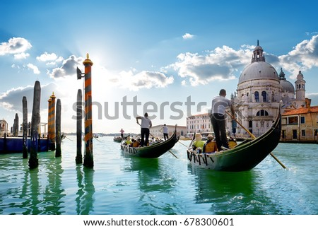 Ride on gondolas along the Gand Canal in Venice, Italy. #678300601