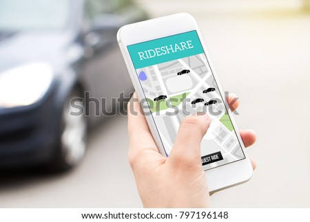 Ride share taxi service on smartphone screen. Online rideshare app and carpool mobile application. Woman holding phone with a car in the background. Person ordering ride with cellphone. #797196148