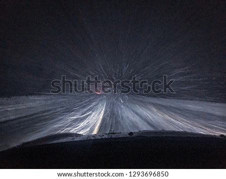Ride through the night snow blizzard in the countryside of Russia.