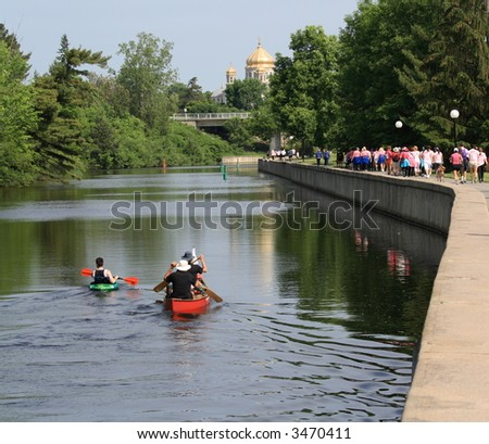Rideau Canal with canoeists during breast cancer walk. Ottawa, Ontario. Canada.