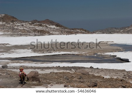 Rider in the Snowy Mountains
