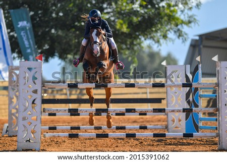 Rider on horse jumping over a hurdle during the equestrian event Foto stock ©