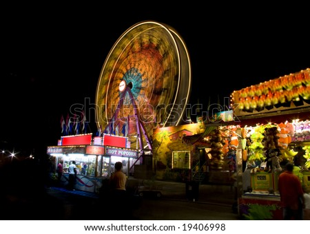 Rides and food stands at the state fair.