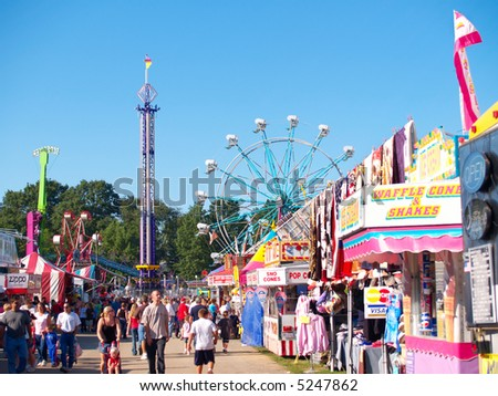 Rides, concessions, and crowds at a county fair