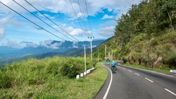 Riding a Bicycle Down the Hill Towards Horton Plains National Park From Haputale Town, Sri Lanka