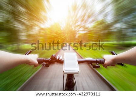 stock photo riding a bike first person perspective smartphone attached to handlebar speed motion blur 432970111 - Каталог - 3d фотообои