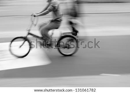 Riding a bike on city street - stock photo