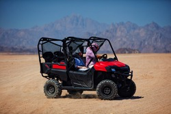 riding a buggy car through the desert. thrill tourism adventures