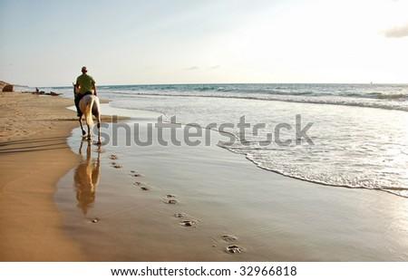 Riding a horse at the beach