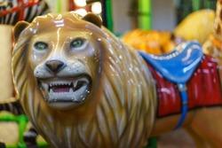 Riding around a lion carousel