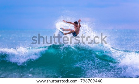 Riding the waves. Costa Rica, surfing paradise. Josue Rodriguez, a talented Costa Rican surfer Сток-фото ©
