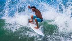 Riding the waves. Jeison Torres, one of the top ten surfers in Costa Rica, surfing paradise