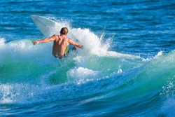 Riding the waves. Surfer, Costa Rica