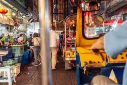 Riding Tuk Tuk at night in Bangkok, Thailand - popular among tourists city taxi
