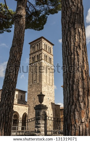 Rieti (Lazio, Italy) - Belfry of the Cathedral, in Romanesque style, and pines