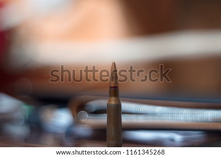 Rifle ammo on blurred background. Close-up view.
