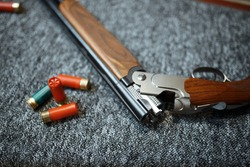 Rifle and ammo in gun shop, closeup, nobody