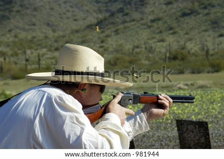 "Rifle shooting competition at a ""cowboy action shoot""."