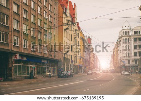 Riga, Latvia July 8, 2017 Brivibas street in perspective view, modern city street with old architecture #675139195