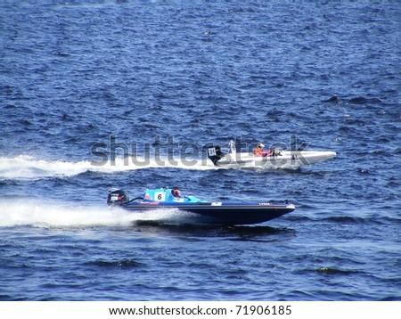 """RIGA, LATVIA - 24 JULY: Rigid Inflatable Boat race """"Six hours of Riga"""" in Riga, Latvia, on july 24, 2010."""
