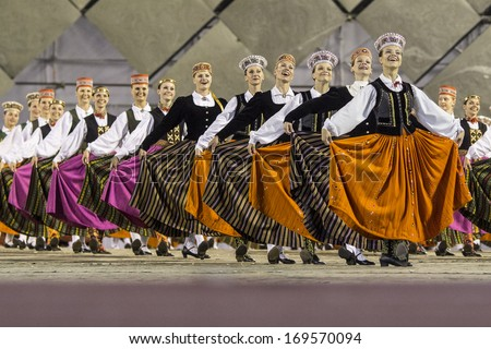 RIGA, LATVIA - July 4, 2013: The Latvian National Song and Dance Festival. Latvian dance grand performance at Our Fathers Piers