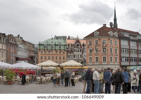 RIGA, LATVIA - JUNE 02: Unrecognized tourists visit Dome Square on June 02, 2012 in Riga, Latvia. The Riga Dome Square development started in the end of the 19th century and continued till 1936.