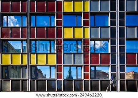 Riga, Latvia, March 08 2014: Reflection facade of modern building near Church of Gertrude in Riga