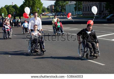 RIGA, LATVIA - MAY 23:  Disabled people participate in the Riga International Marathon in May 23, 2010, Riga, Latvia.