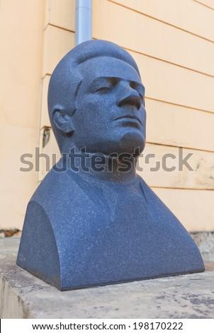 Riga, Latvia - May 25, 2014: Sculpture portrait of Emils Darzins, Latvian composer, music critic and pedagogue. Facade of Exhibition hall Arsenals in Riga, Latvia. Work of sculptor Marta Lange, 1975