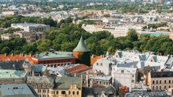 Riga, Latvia. Riga Cityscape In Sunny Summer Day. Famous Landmark - Powder Tower.