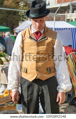 RIGA, LATVIA – SEPTEMBER 25: People in national costumes celebrating the Latvian harvest holiday Mikeldienas on September 25th, 2010. #1092892148