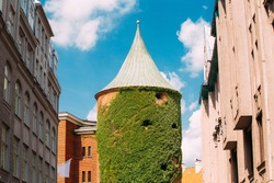 Riga Latvia. View Of Powder Tower On Smilsu Street In Sunny Day Under Summer Blue Sky