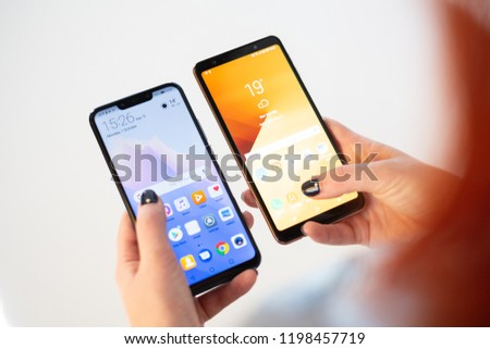 RIGA, OCTOBER 2018 - Recently launched Huawei Mate 20 Lite and Samsung Galaxy A7 smartphones are displayed for editorial purposes