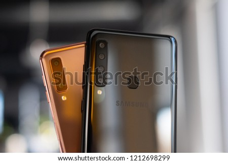 RIGA, OCTOBER 2018 - Recently launched Samsung Galaxy A9 and A7  (2018) smartphones are displayed for editorial purposes