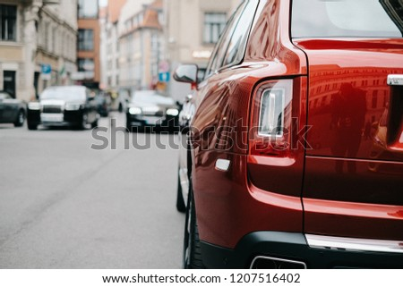 RIGA, OCTOBER 2018 - The Rolls-Royce Cullinan, a full-size luxury SUV, is displayed for media and general public in Riga.  Shallow focus and soft film grain effect.