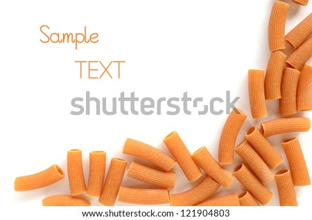 Rigatoni arranged in a half frame with room for text on white background