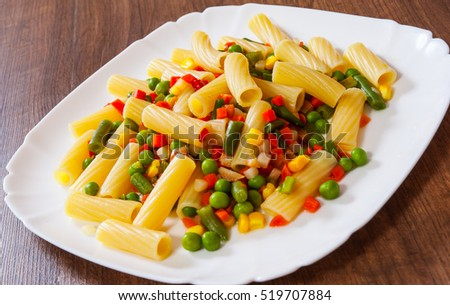 rigatoni pasta with mixed vegetables on white plate #519707884