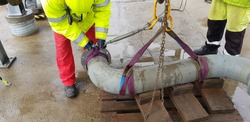 riggers sling the pipe using webbing  slings with turnbuckle and prepare for the lifting operation