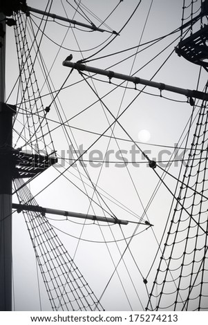 Rigging Mast of old sail ship. Black and white photography.